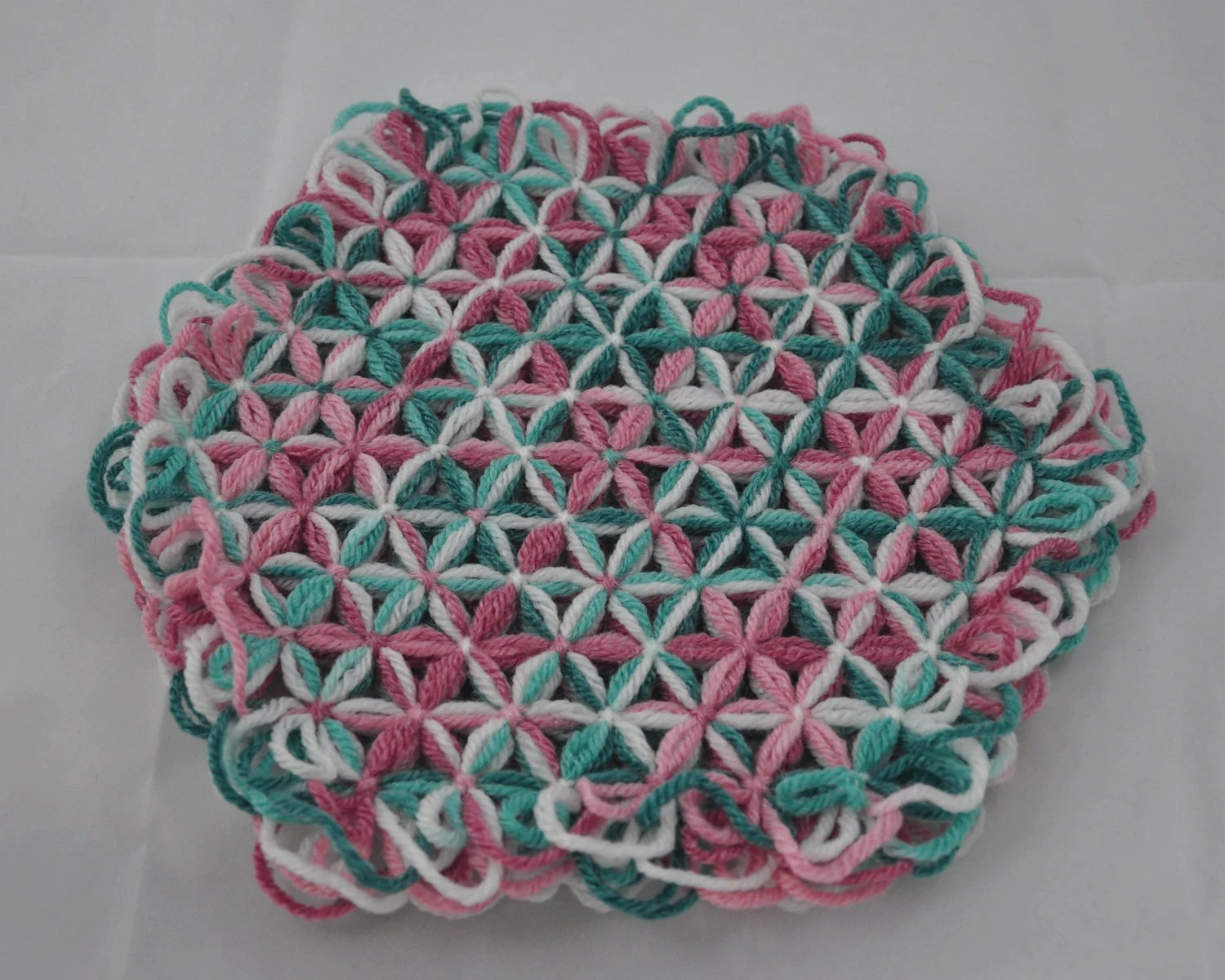Small Trivet in 4 Layers of Rambling Rose Mluticolor Yarn with Rambling Rose Ties - Spring Easter Egg Colors