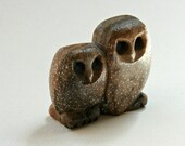 Spotted owl mother and baby stone vintage
