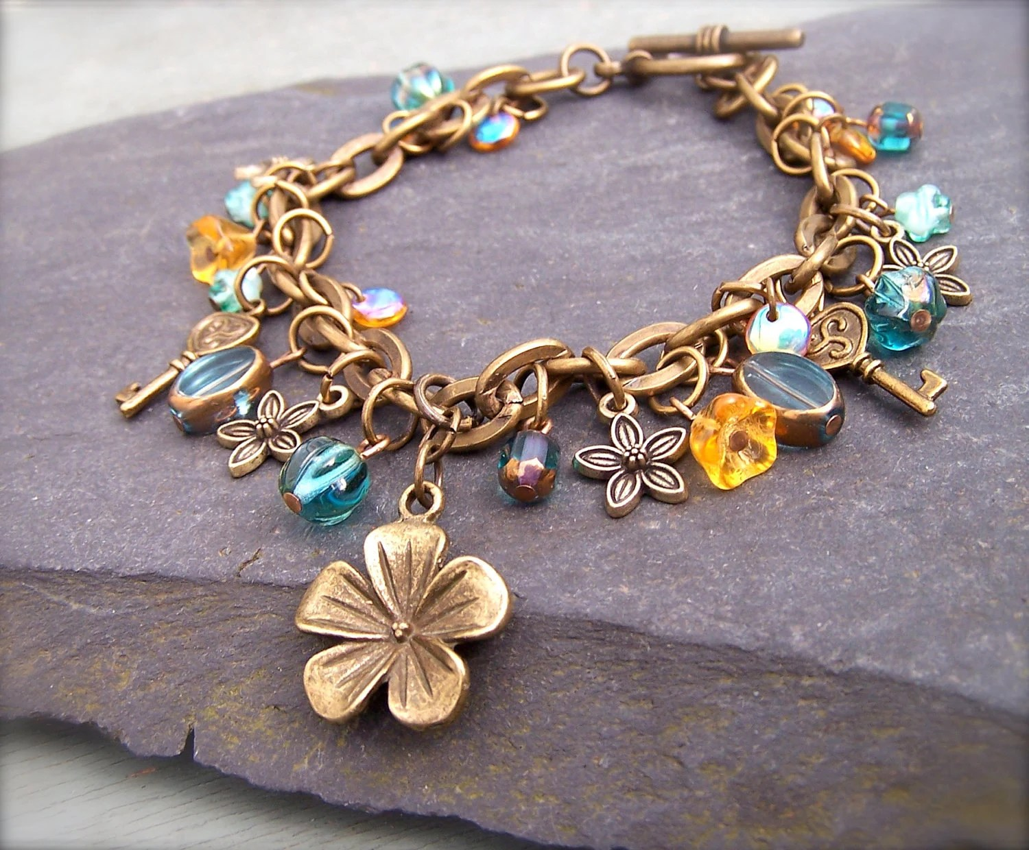 Brass Charm Bracelet, Antique Brass Flower Charm, Aqua Blue, Pale Yellow Beads, Keys, Flowers - Phoebedreams