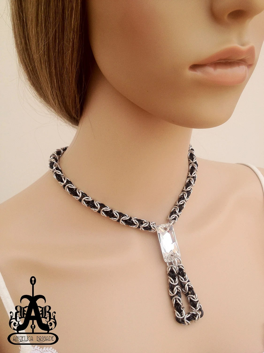 Contemporary Chain Maille Necklace with a Large Swarovski Crystal Centerpiece, US$60 Made to order. http://www.etsy.com/listing/89827486/contemporary-chain-maille-necklace-with An original design by joyz*k of Angelica Brigade