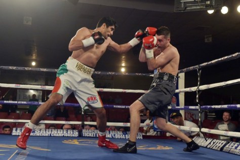 Vijender Singh continued his sensational foray into professional boxing with a second successive knockout triumph, demolishing England's Dean Gillen in the first round itself. The 30-year-old, who had clinched a Technical Knockout against another Englishman Sonny Whiting in his debut bout, was in rampaging form yet again as he finished off Gillen just over two minutes into the contest. Walking in to the beats of a live dhol, Vijender looked supremely confident as he measured up Gillen in the first 20-30 seconds. With a deadly right straight, the former Olympic bronze-medallist had the Brit down on the mat quite early in the bout. (Getty Images)