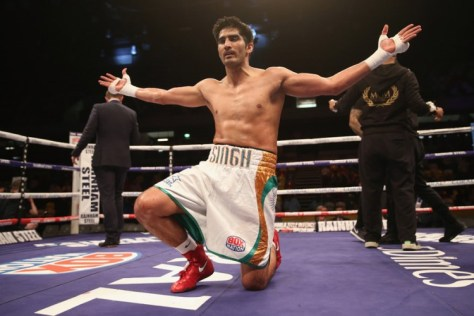 Indian boxing star Vijender Singh's power-packed punches went unchallenged yet again as he notched up his fifth successive knockout win by battering Frenchman Matiouze Royer. Vijender was declared winner little over a minute into the fifth round of the six-round super middleweight contest, which was incidentally his longest bout so far. The 30-year-old was up against his most experienced rival till date in Royer, who came into the bout with an accumulated 250 rounds under his belt. (Getty Images)