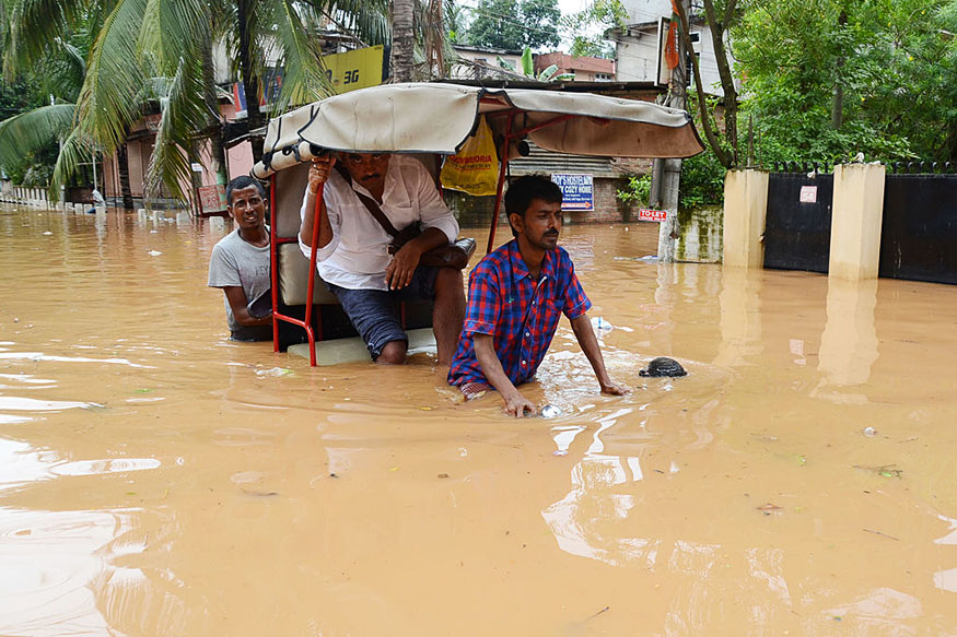 Rickshaw puller in flooded Guwahati