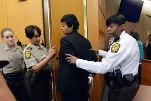 Former Deerwood Academy assistant principal Tabeeka Jordan, center, is led to a holding cell after a jury found her guilty in the Atlanta Public Schools test-cheating trial Wednesday.