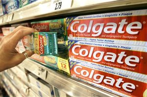 A shopper takes a box of Colgate toothpaste off the shelf at the Heinen's grocery store in Bainbridge, Ohio in this April 26, 2006 file photo.  Colgate-Palmolive Co. is expected to release quarterly earnings on Wednesday, April 25, 2007. (AP Photo/Amy Sancetta, file)