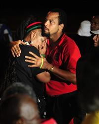 Vizion Jones, center, holds Mercedes Binns, left, after hearing the news of the execution of Georgia death row inmate Troy Davis in Jackson, Ga., Wednesday, Sept. 21, 2011.