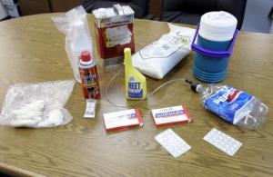 In this file photo, examples of a items used in the production of methamphetamine sit on a table inside the Pratt County Sheriff office in Kansas.