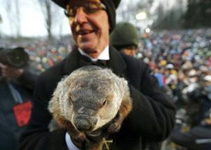 Groundhog Club Co-handler Ron Ploucha holds the weather-predicting groundhog, Punxsutawney Phil, after the club said Phil did not see his shadow and there will be an early spring.