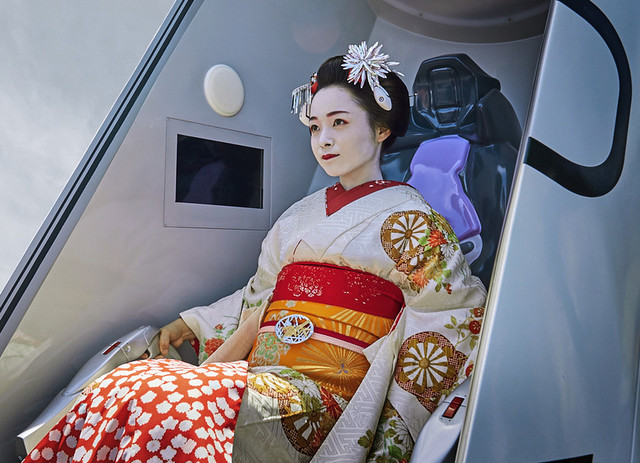An actress dressed as a geisha tests her synchronization rate in the entry plug attraction of the Evangelion Kyoto Base at Toei Kyoto Studio Park.