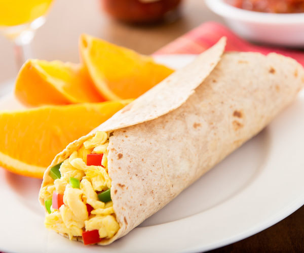 Healthy egg white breakfast burrito recipe with bell peppers and turkey bacon.