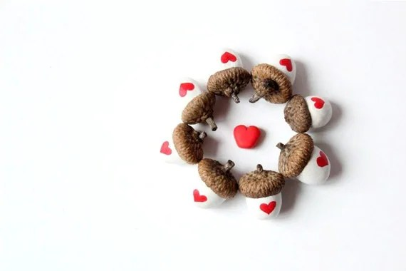 http://www.etsy.com/listing/66579067/heart-acorns-with-real-acorn-caps-set-of?ref=sr_gallery_39&ga_search_submit=&ga_search_query=acorns+hearts&ga_page=2&ga_search_type=handmade&ga_facet=handmade