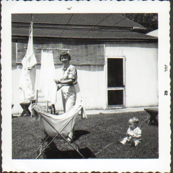 Wash Day Vintage Photo of a Woman Hanging Clothes on a