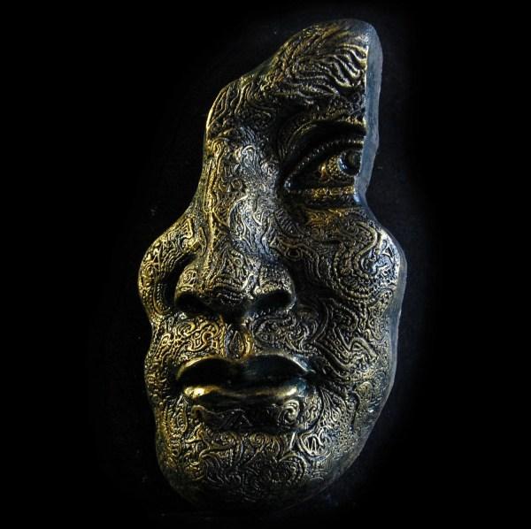 Stone Face Sculpture