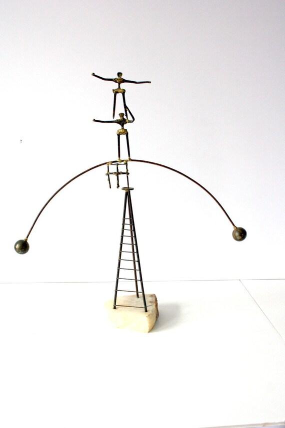 Vintage metal sculpture kinetic balancing acrobats