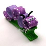 purple caterpillar ribbon sculpture