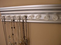 Lots of jewelry storage on this wall hung necklace holder