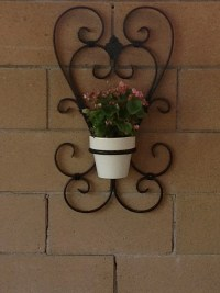 Two heart wrought iron flower pot holder