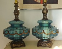 A Pair of Blue Glass Ornate Lamps