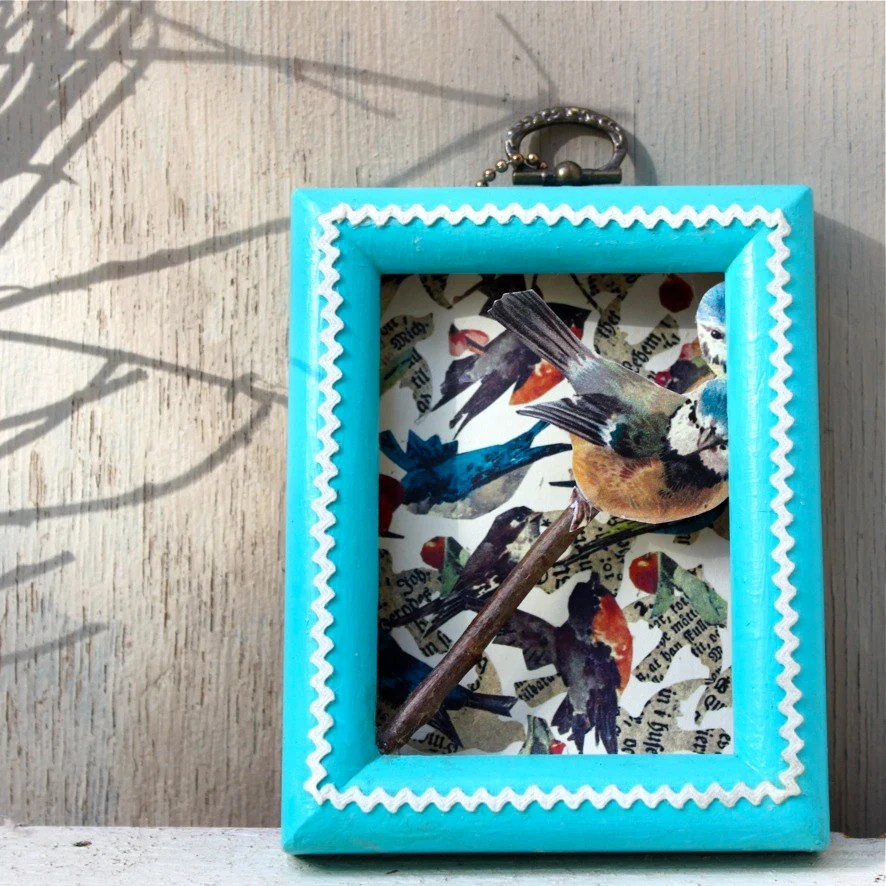 Original bird collage with vintage frame, rick-rack, with bird cutout on a branch, Scandinavian
