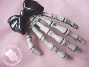 black skeleton hand hair clip