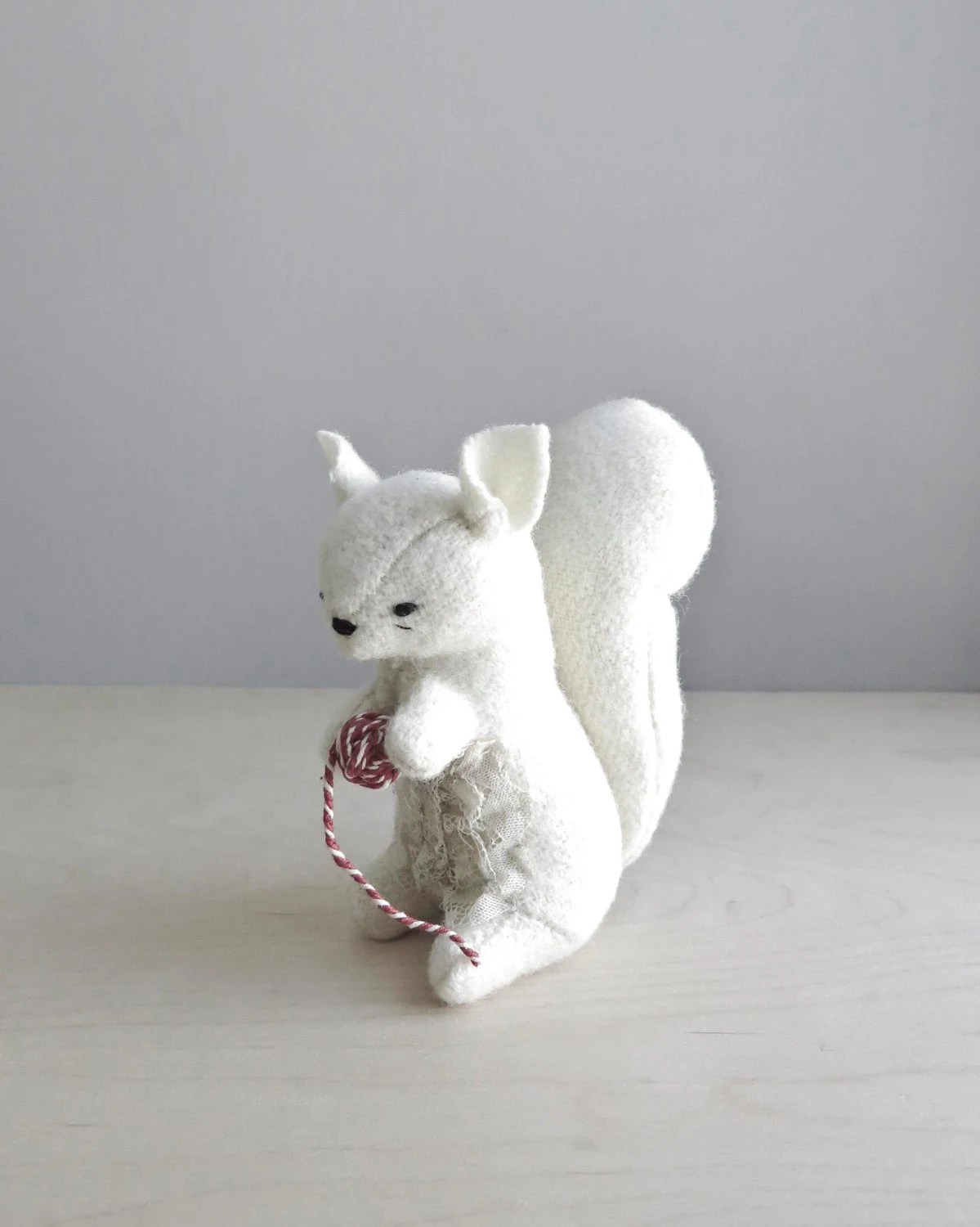 white squirrel with string / soft sculpture animal