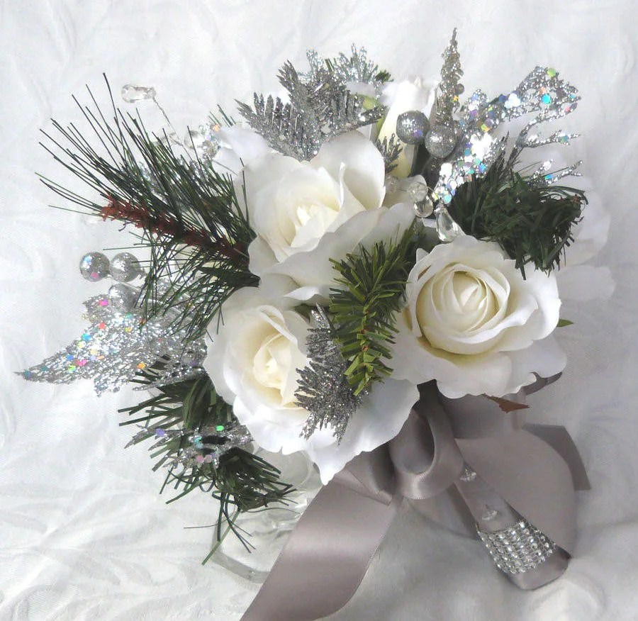 Winter wedding bouquet and boutonniere white roses silver