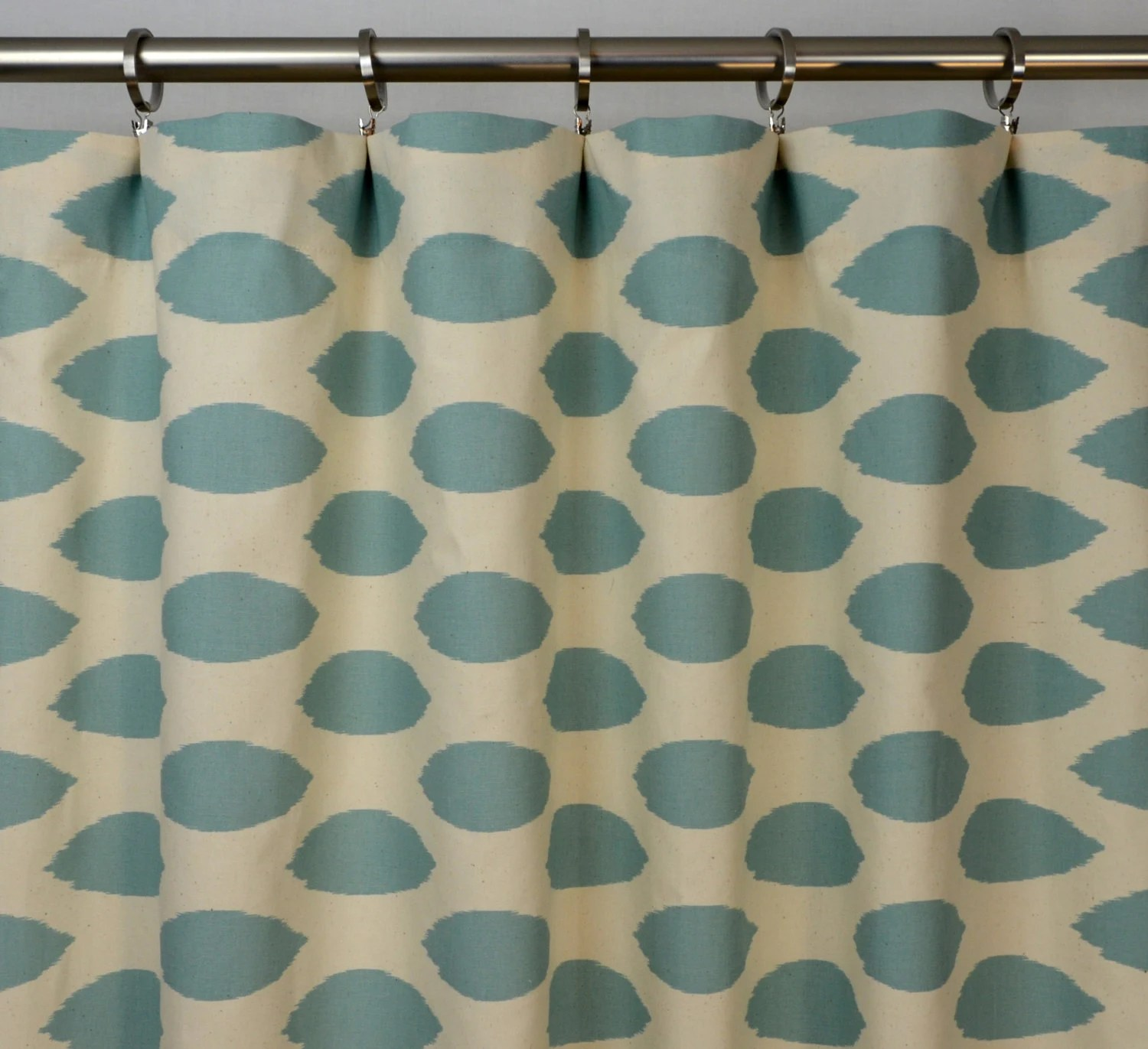Pair of Rod Pocket Curtains in Village Blue and Natural Chipper Ikat print