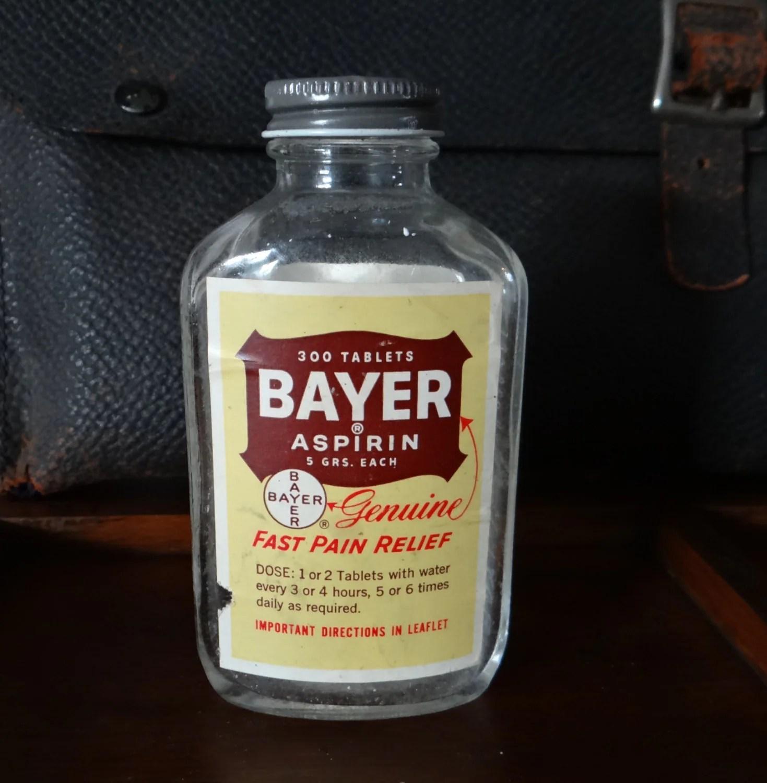 vintage electric chair fishing rod holder bayer aspirin bottle glass metal lid