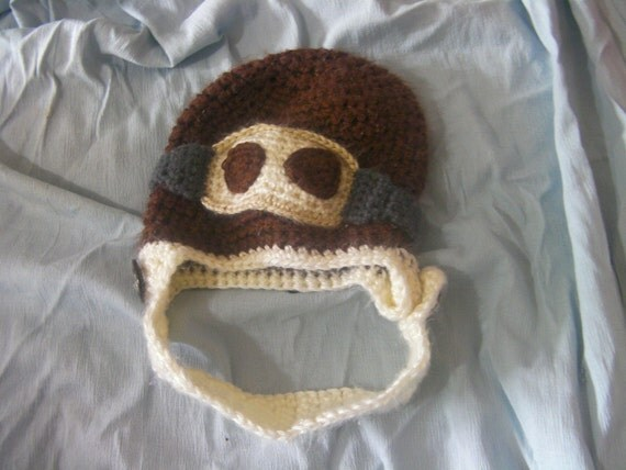 Aviator Hat with Goggles and adjustable chin strap that can be buttoned on both sides of hat