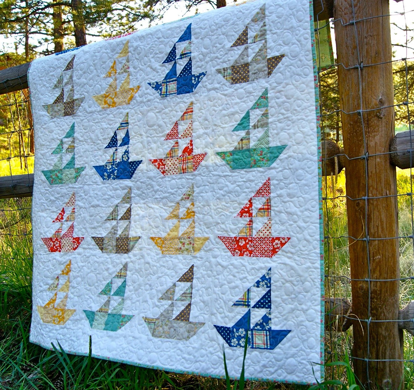 hanging chair stand white vitra office price quilt baby lap handmade seaside sailboats riley blake summer