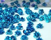 50 Cyan Aluminum Flowers 6mm - TheMark44