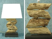 Stacked driftwood lamp with dark stained wood base. Beach