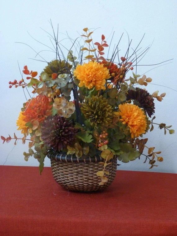Small fall silk floral basket centerpiece orange gold mums