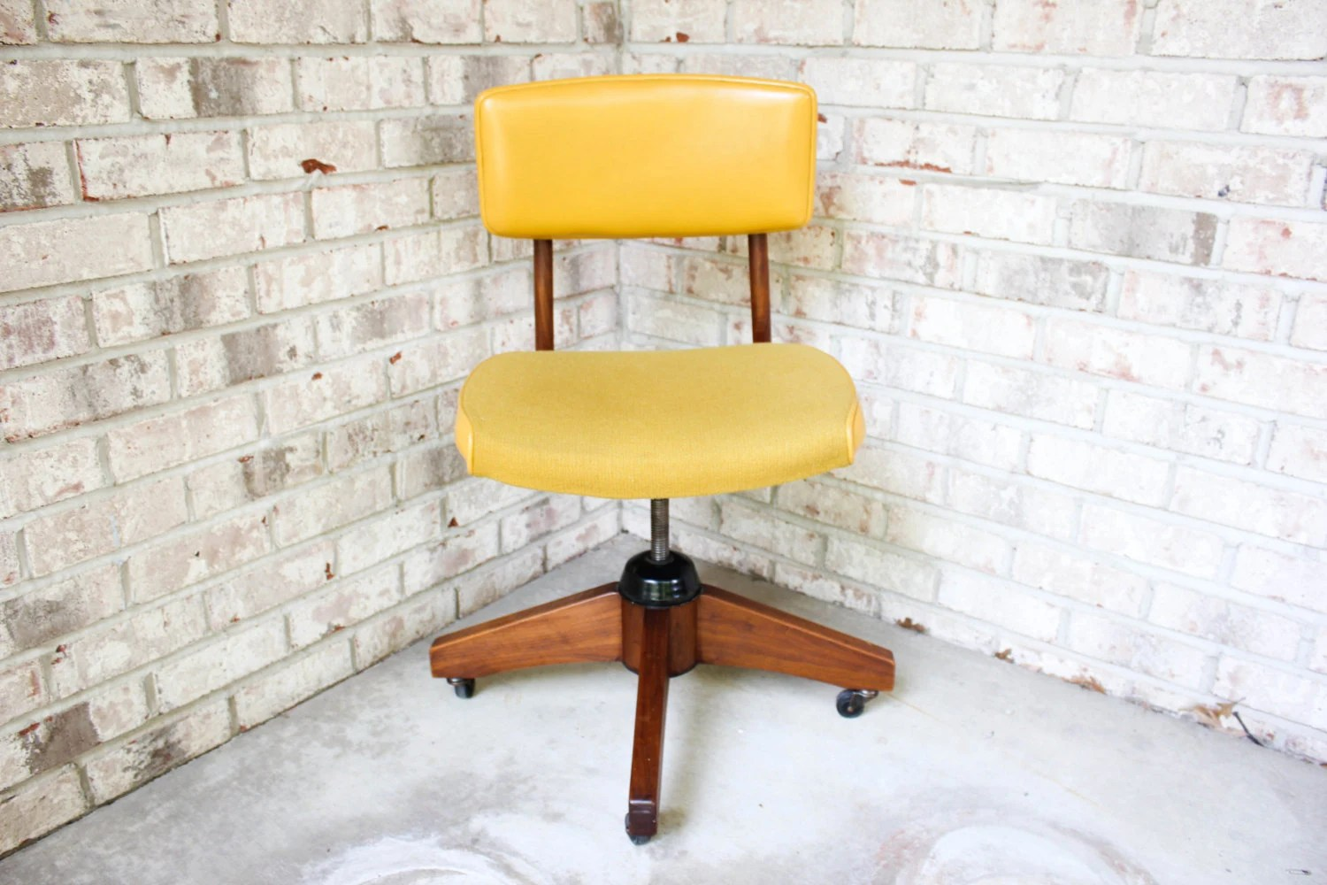 swivel chair mustard yellow plastic stackable lawn chairs rare mid century modern and walnut the