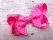 small bright pink boutique bow