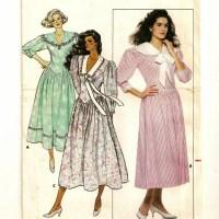 A Fitted Below Calf Length Flared Skirt Drop Waist Dress