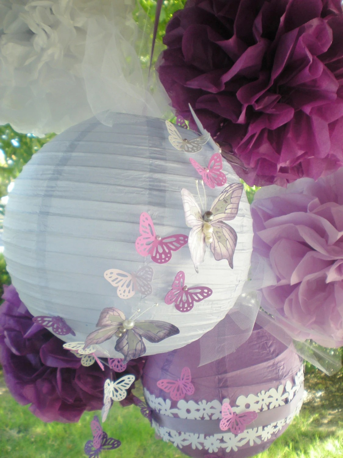 Purple pom poms and paper lanterns radiant orchid with hand-painted butterflies, set of 4 pom poms and two lanterns - DellaCartaDecor