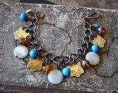Vintage Cat's Meow Charm Bracelet in Blue and Butterscotch - Vintage Assemblage