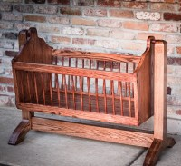 Swinging wooden baby cradle handmade from red by ...