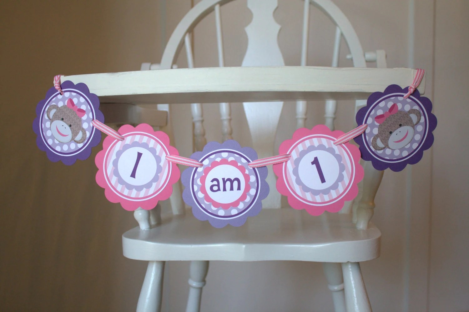 monkey high chair farmhouse table and 4 set miss sock banner first birthday photo