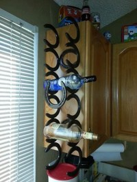 Horseshoe side cabinet wine rack holds six bottles