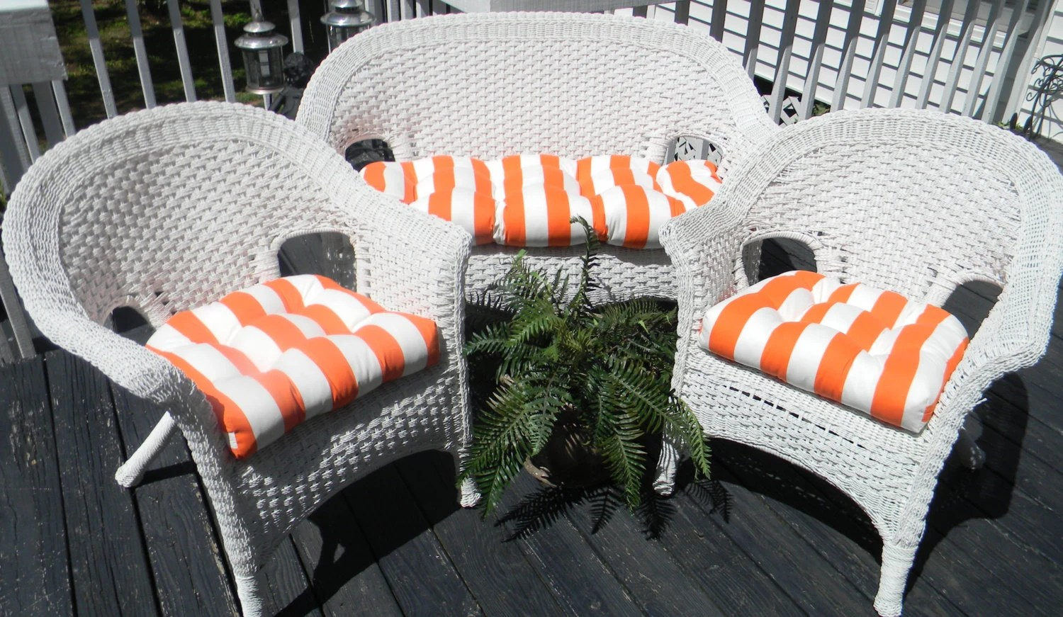 orange wicker chair cushions eames style lounge and ottoman rosewood black leather white stripe for loveseat settee