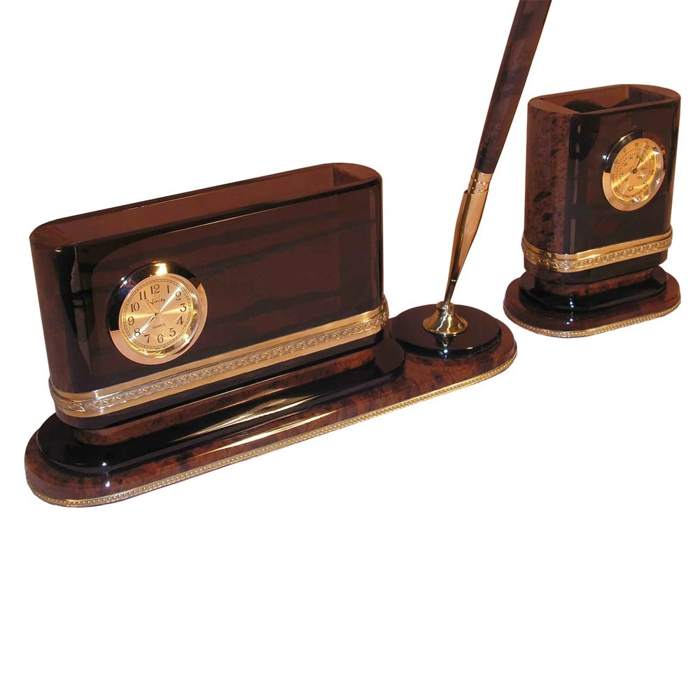 Small office desk organizer made from obsidian and brass with