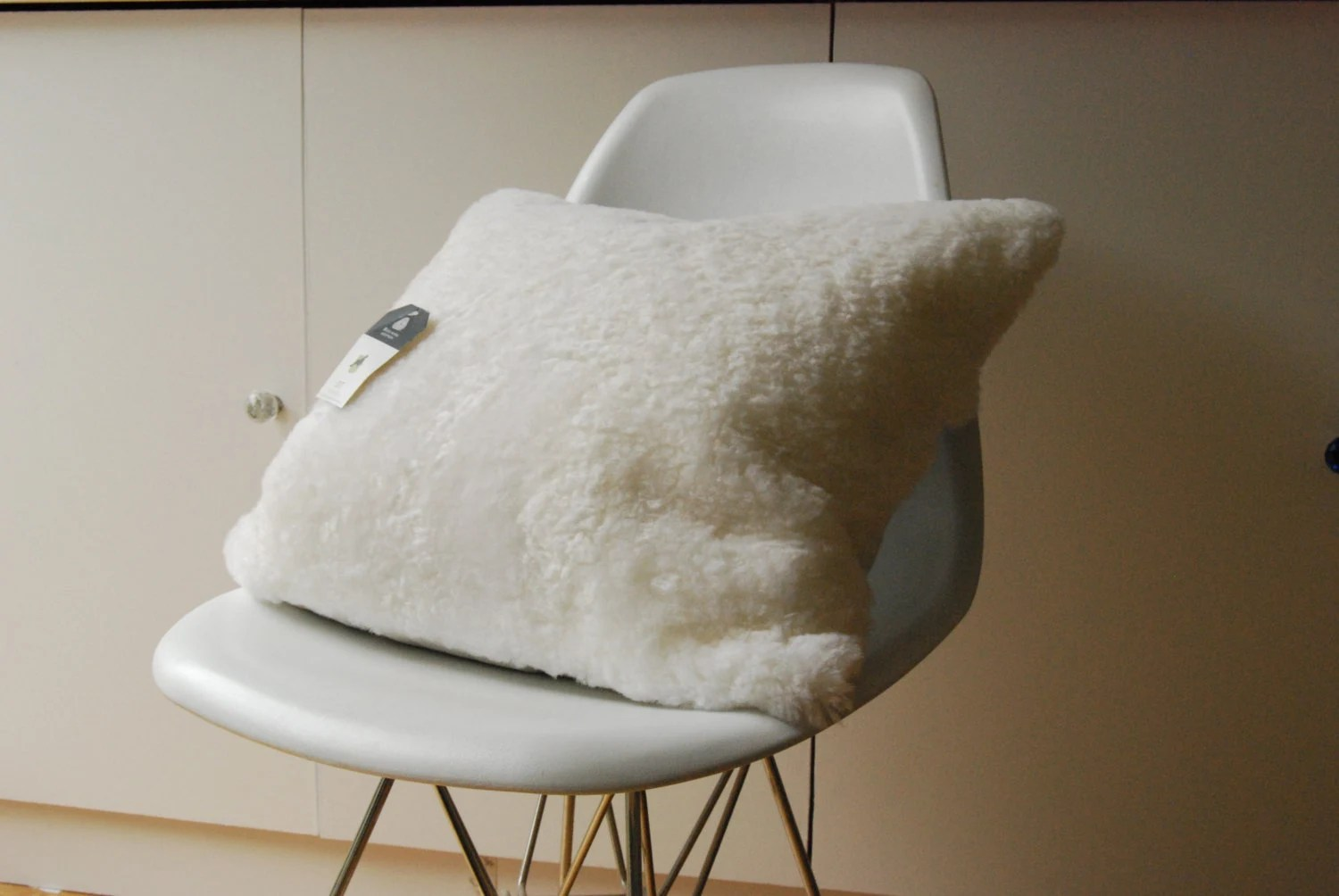 sheepskin chair pad australia barrel chairs swivel rocker ivory shearling cushion cover fur pillow