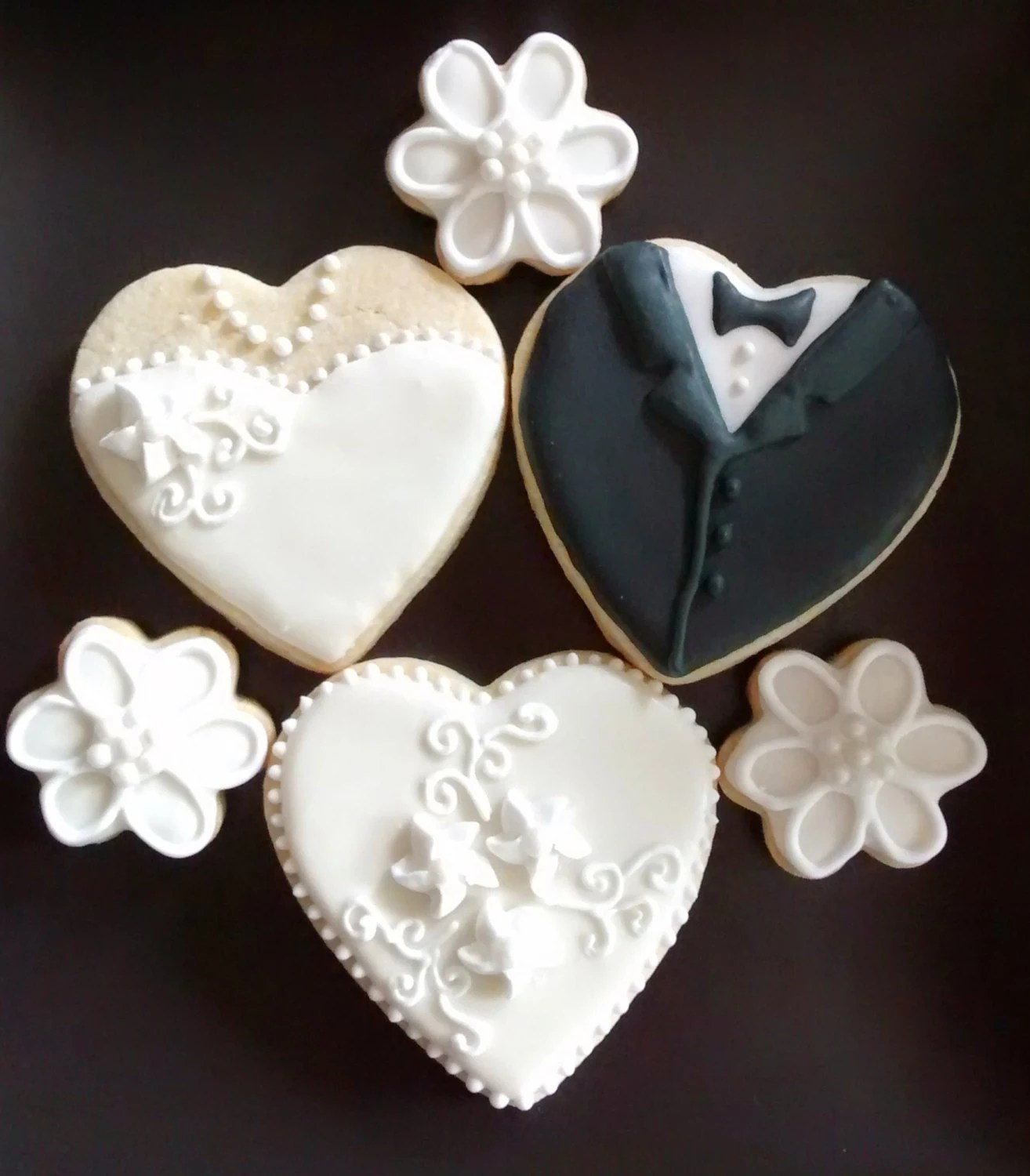 Wedding bride and groom heart cookies and bite size flowers