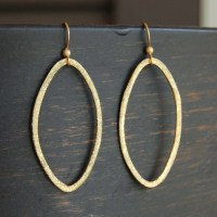 Items similar to Brushed Gold Oval Hoop Earrings on Etsy