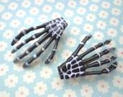 2 skeleton hand hair clips set