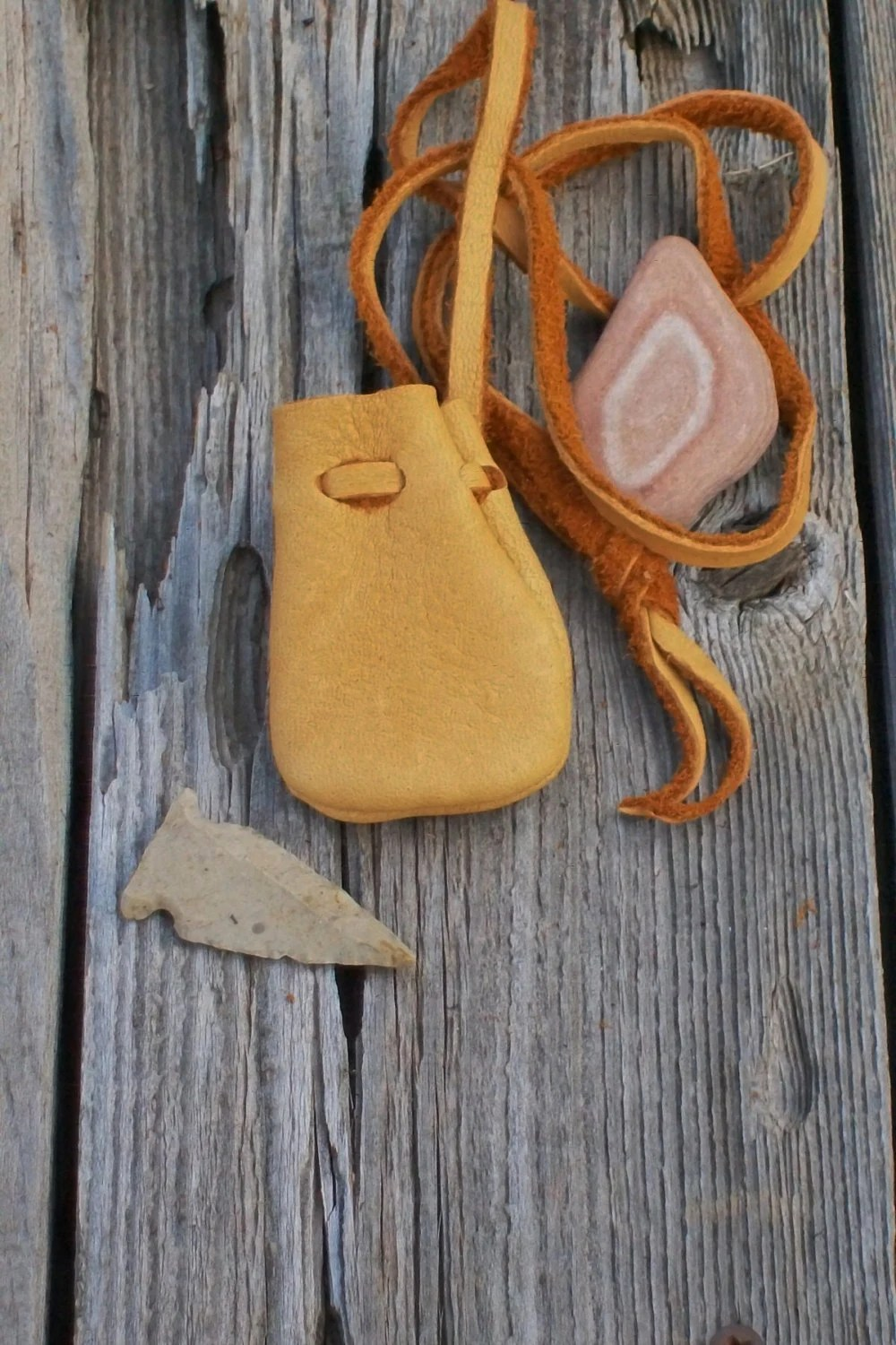 A small leather neck pouch for your medicines and by