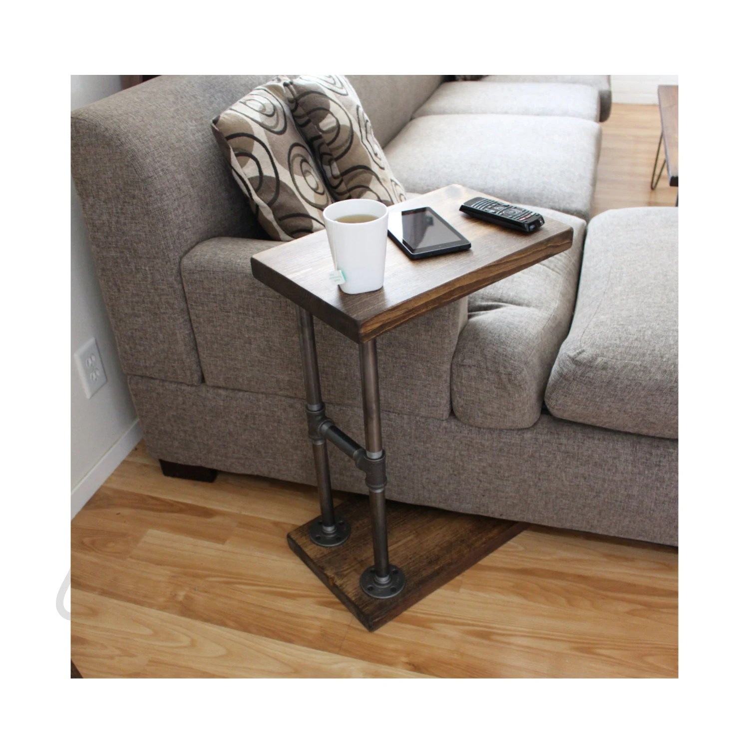 small table that slides under sofa extra deep seated uk industrial furniture coffee side laptop stand