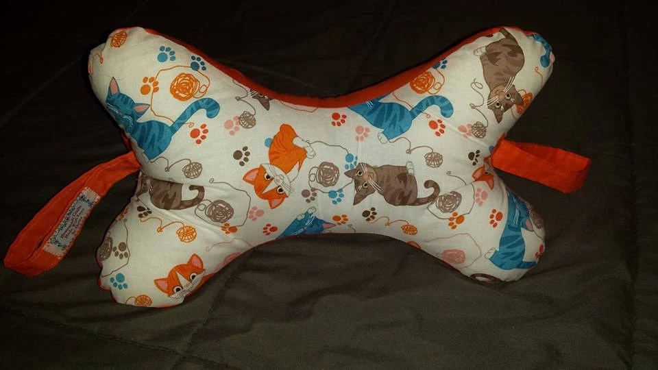 Dog Bone Shaped Neck Pillow with handles by MadewithLovebyDeena